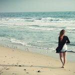 10 ways to walk at home girl walking on beach