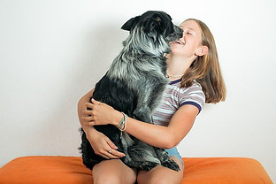 DO DOGS MAKE PEOPLE HAPPY? - girl hugging dog